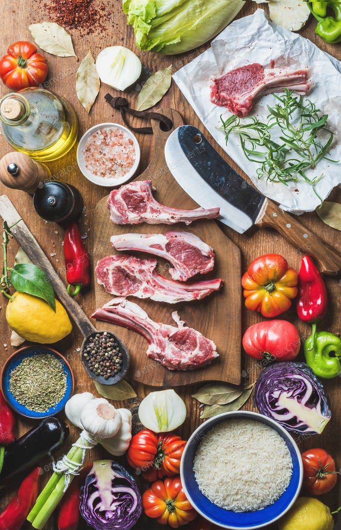 Raw uncooked lamb meat chops, rice, oil, spices and vegetables