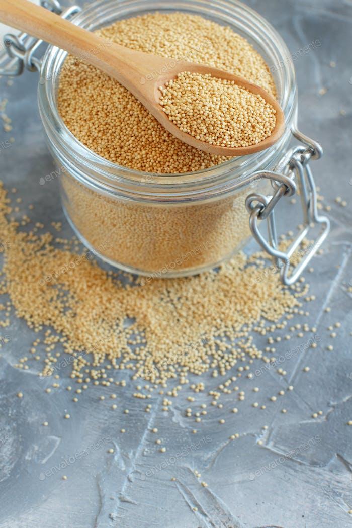 Jar of raw Amaranth Grain with a spoon