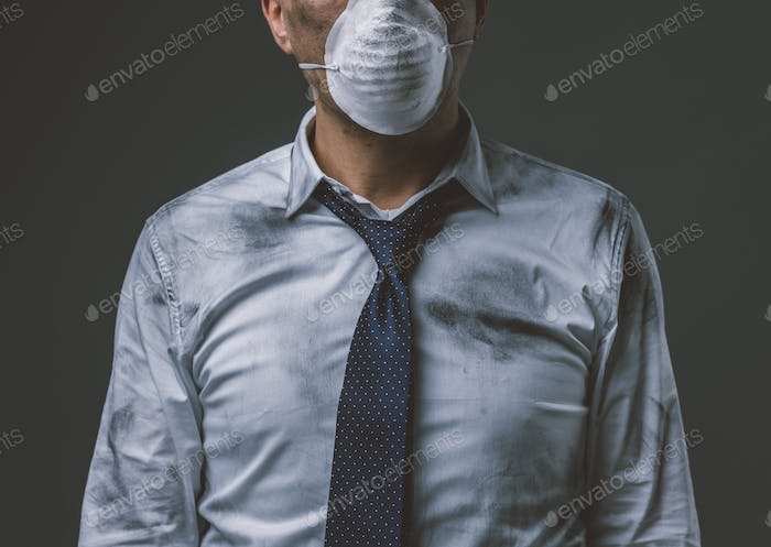 Businessman with mask and air pollution