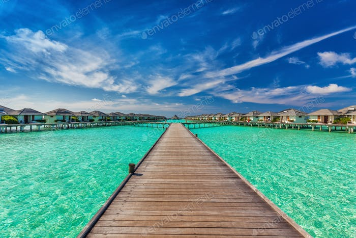 Beautiful water villas on the sea with the bridge, Maldives