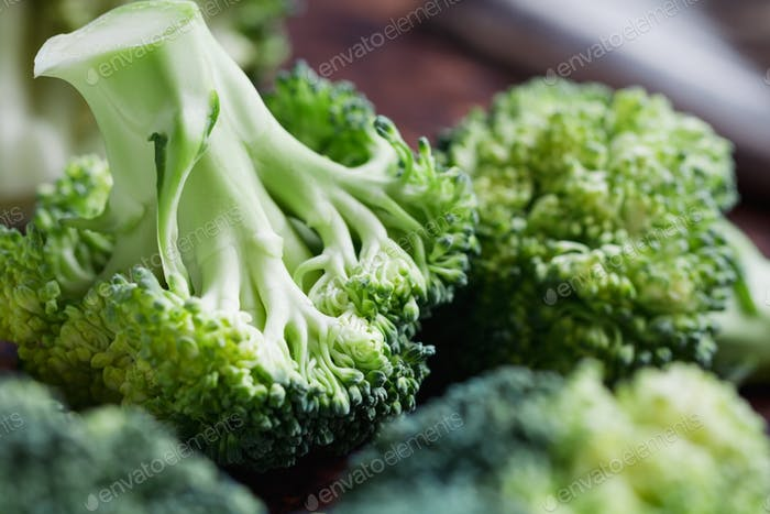 Thumbnail for Close-up of a fresh broccoli on a cutting board. The concept of vegetarian and healthy food.