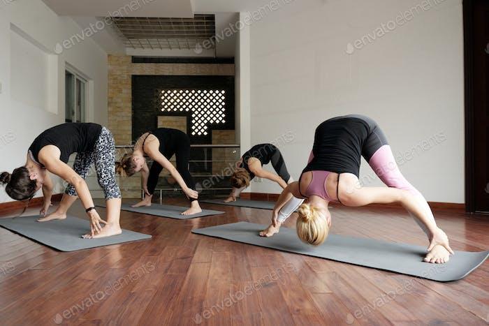 Fit Women Doing Forward Bend