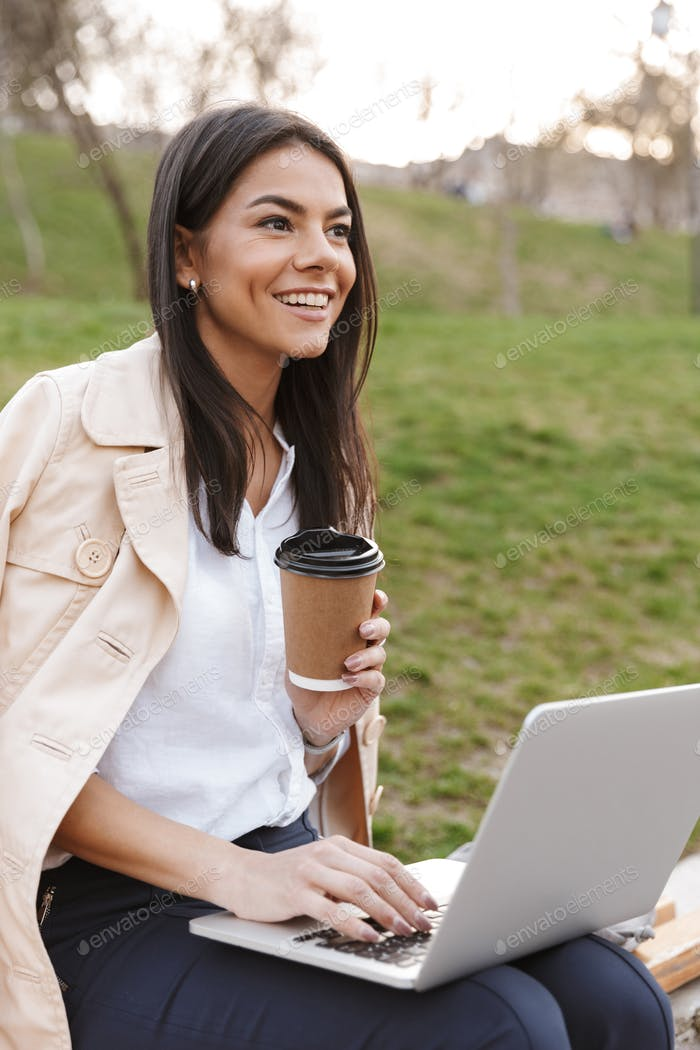 Smiling young woman using laptop computer