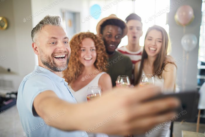 People Taking Selfie at Party