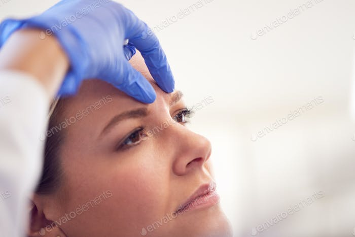 Beautician Or Doctor Preparing Female Patient For Botox Injection