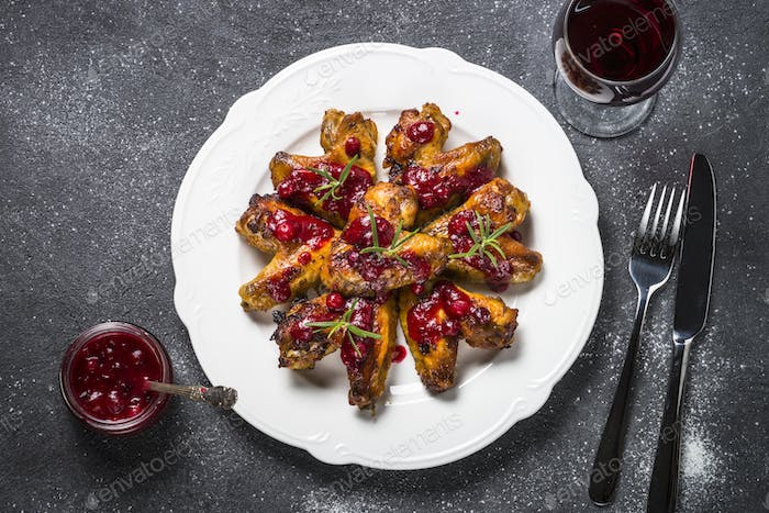 Baked chicken wings in cranberry sauce