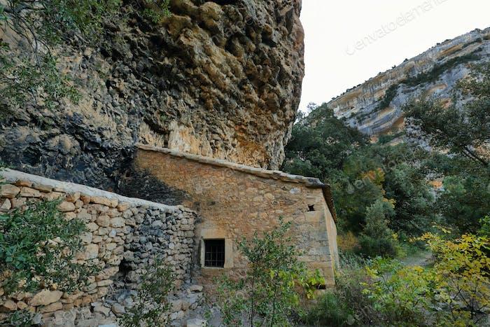 View of San Martín de Lecina Hermitage in Sierra de Guara gorge, Huesca, Spain