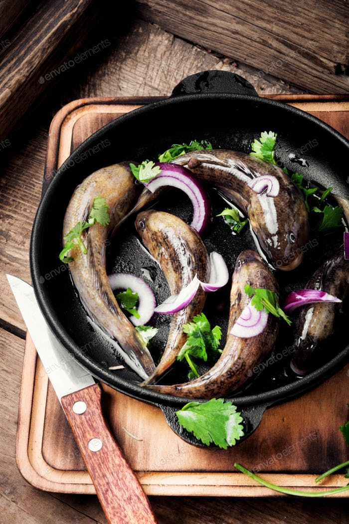 Frying pan with tasty fish