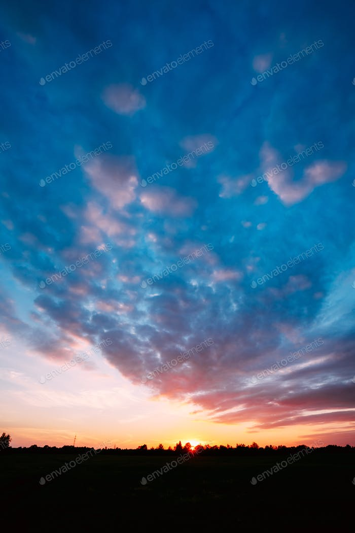 Sunset, Sunrise Over Rural Field Meadow. Bright Dramatic Sky And