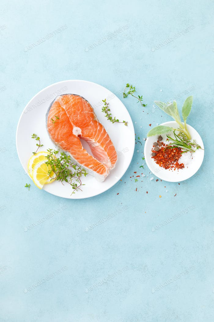 Fresh raw salmon fish steak with ingredients for cooking