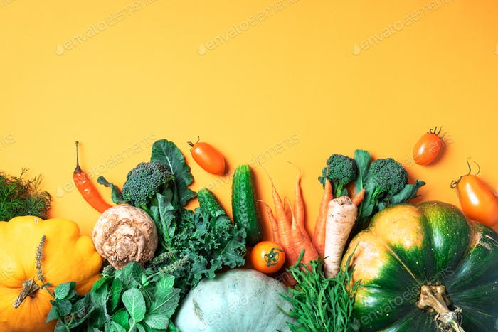 Autumn vegetables on trendy yellow background. Top view. Vegan and vegetarian diet, harvest concept