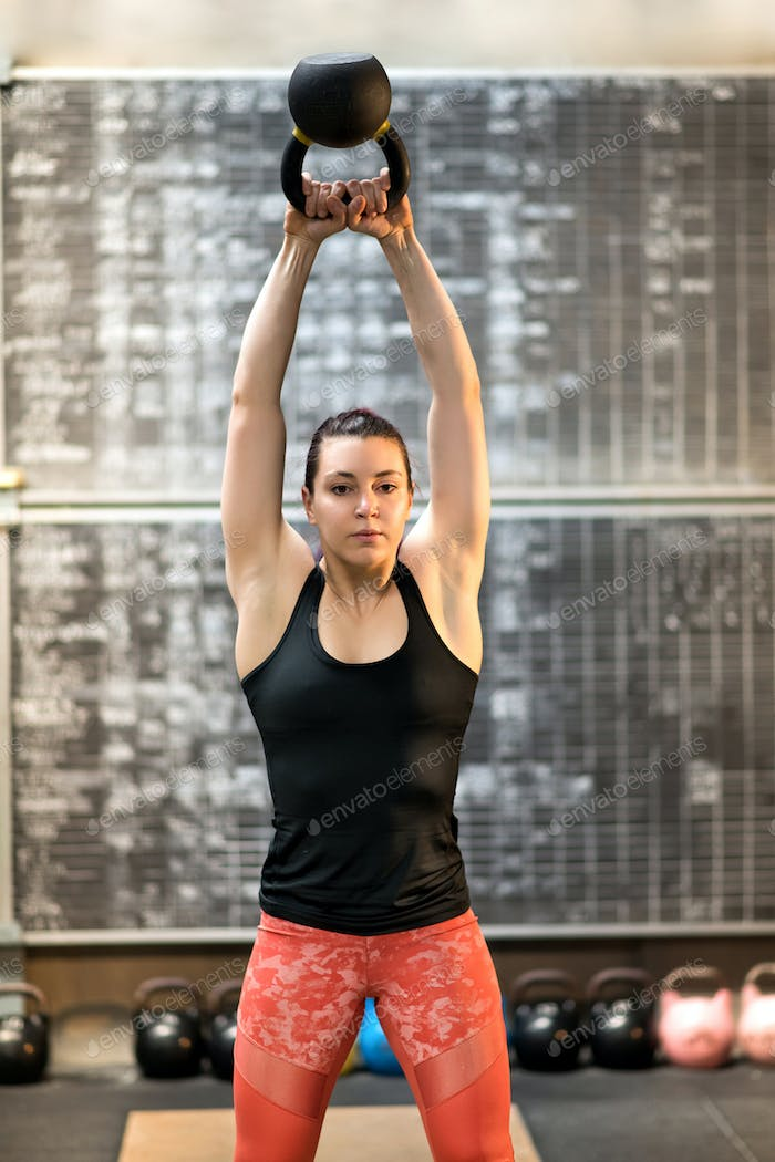 Fit young athlete training with a kettlebell