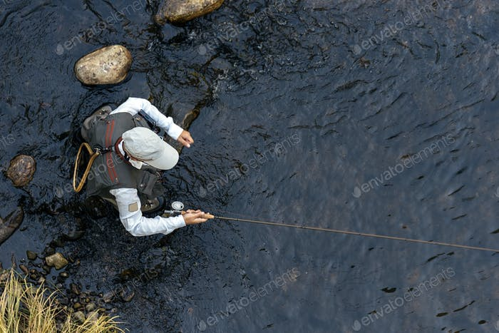 Fly fisherman using flyfishing rod