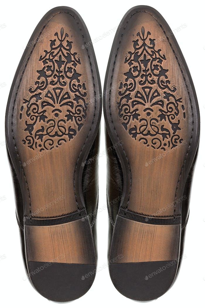 Suela de cuero de zapatos clásicos para hombre, aislada sobre fondo blanco