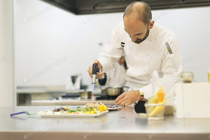 Male professional chef cooking.