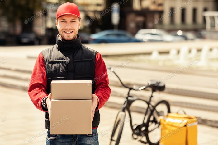 Happy Courier Holding Boxes Smiling Delivering Parcels In City