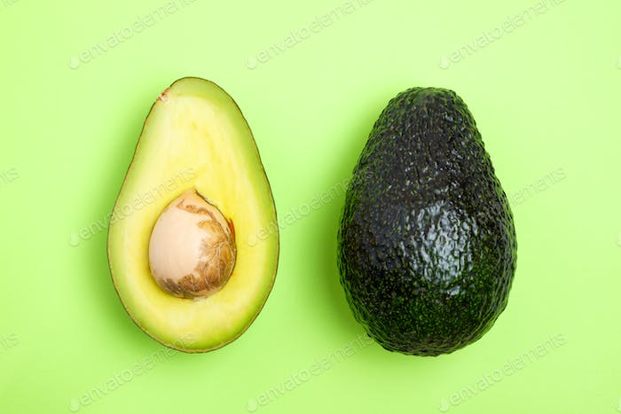 Avocado slice on the green background