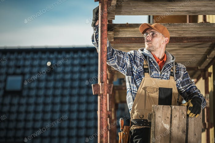 Scaffolding Assembly by Caucasian Construction Worker