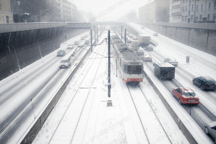 Snowy inner city car and tramway traffic