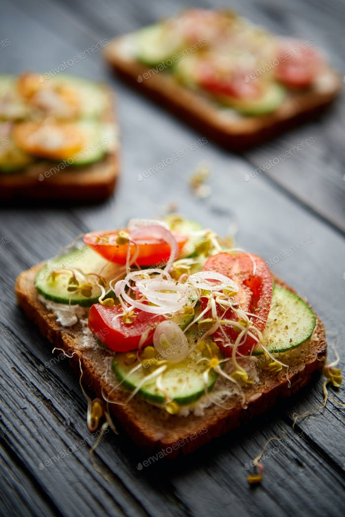 Healthy vege toasts with onion, cucomber, cherry tomatoes