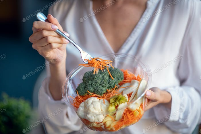 Close up of a bowl with healthy salad