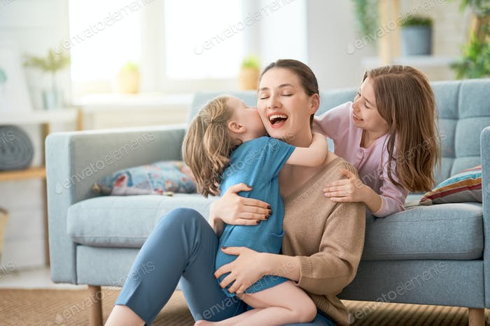 Mom and her daughters are playing