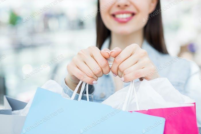Giving shopping bags