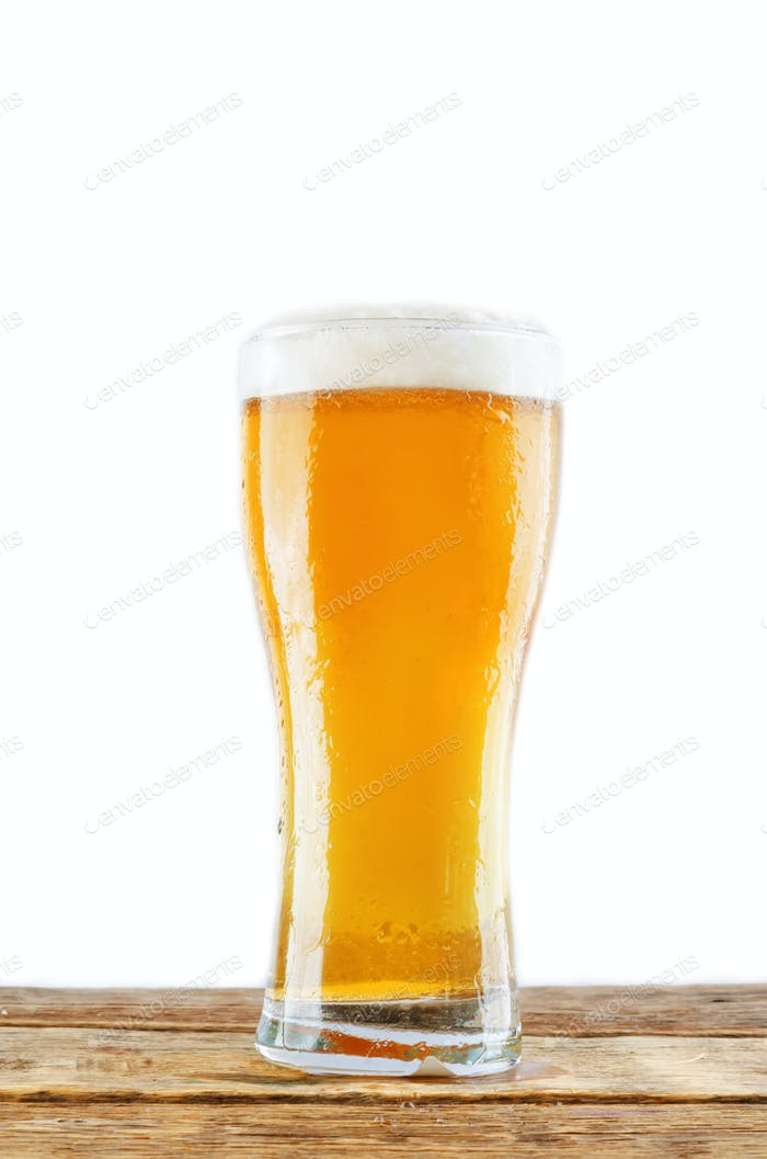 Glass of cold light beer on a wood table