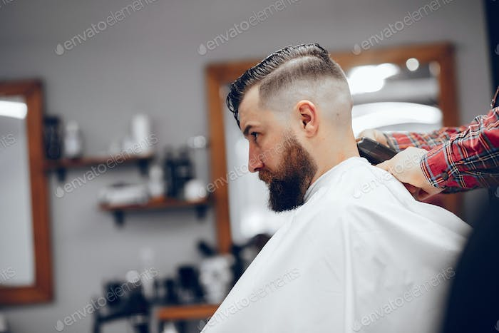 Thumbnail for Stylish man sitting in a barbershop