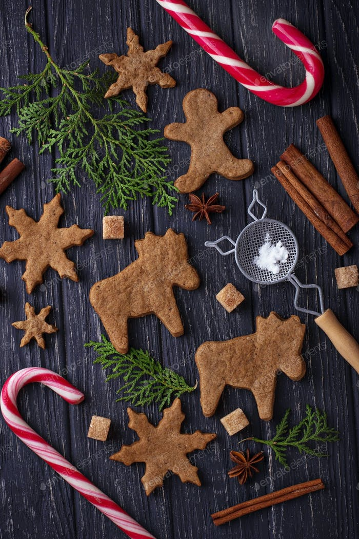 Christmas cookies in shape of deer and snowflake.