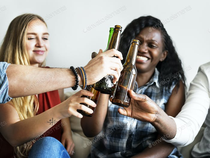 Group of diverse friends drinking beers together