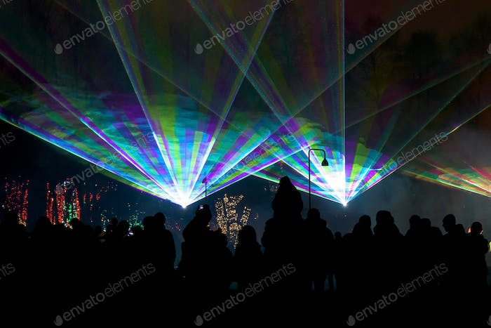 Night laser show with audience