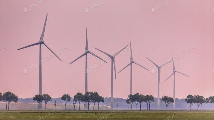 Row of wind turbines in open countryside