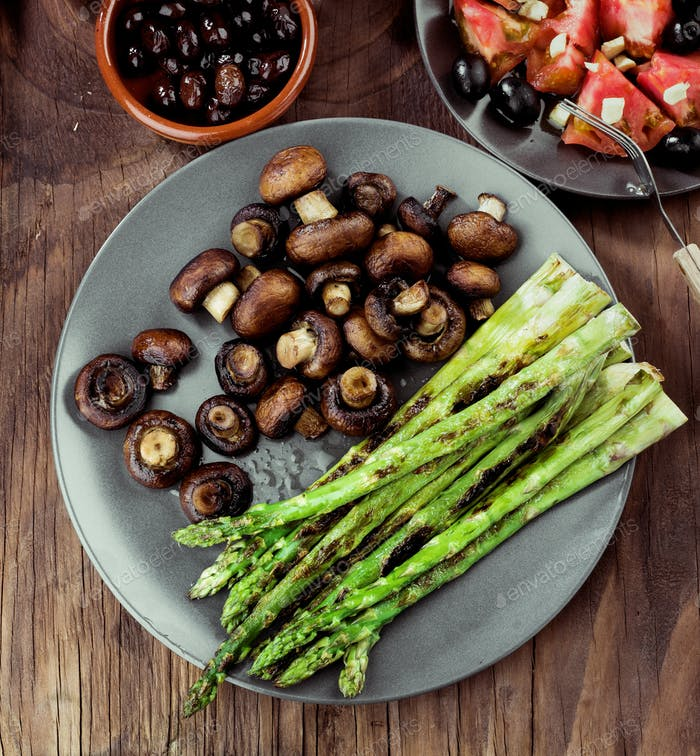 asparagus and toasted mushrooms on rustic wooden board