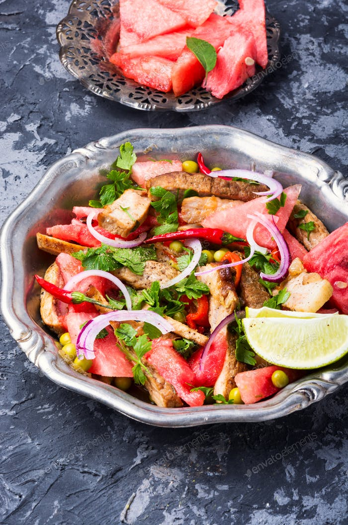 Exotic salad with meat and watermelon