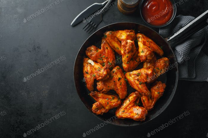 Chicken wings grilled in sauce on pan