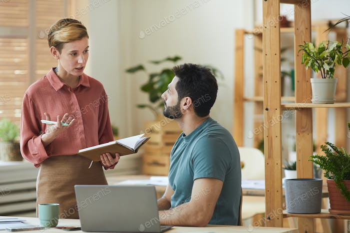 Female Manager Instructing Employee in Office