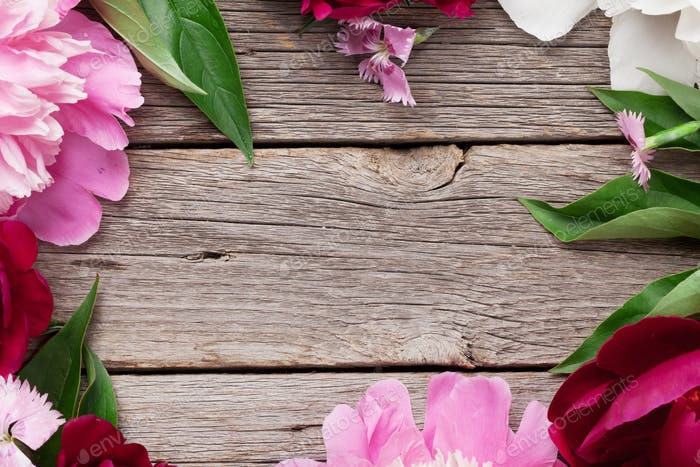 Garden peony flowers on wood