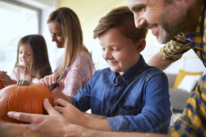 Family preparing decorations for Halloween time