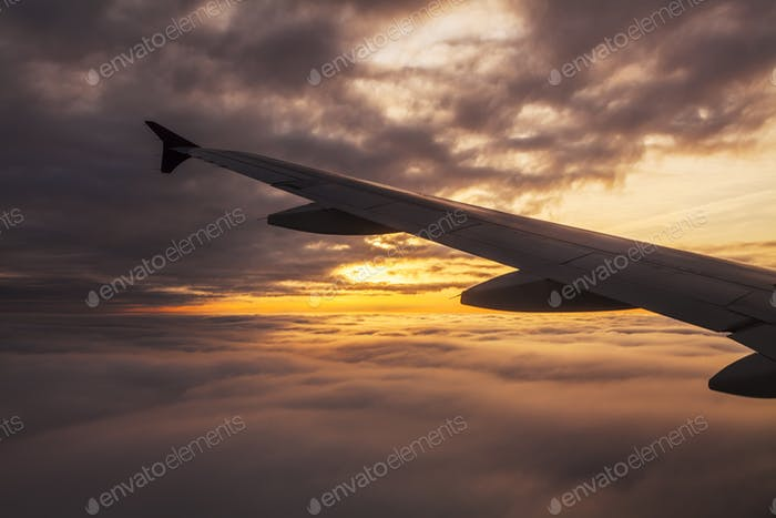 Beautiful sunset. View from the plane window