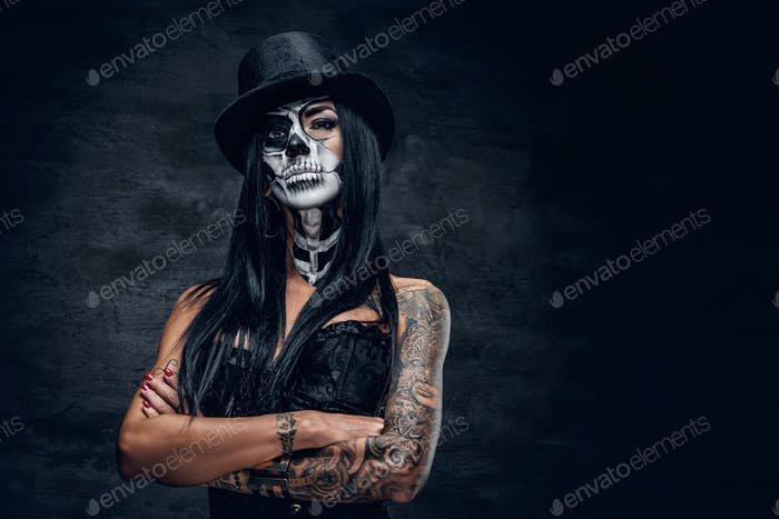 A girl in stylish top hat with skull make up.