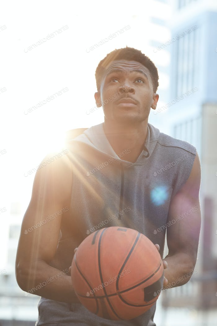 Handsome African-American Man Throwing Ball