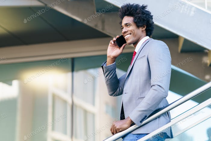 Black Businessman using a smartphone near an office building