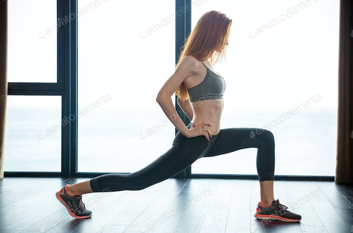 Fitness woman doing warm up exercises