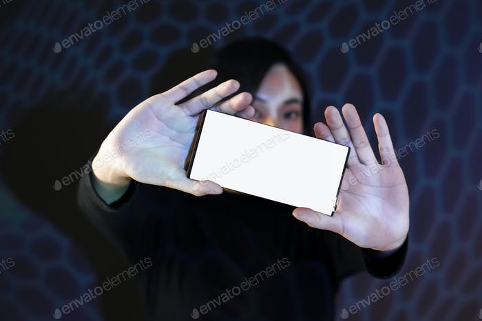 A woman showing her smartphone with both hands