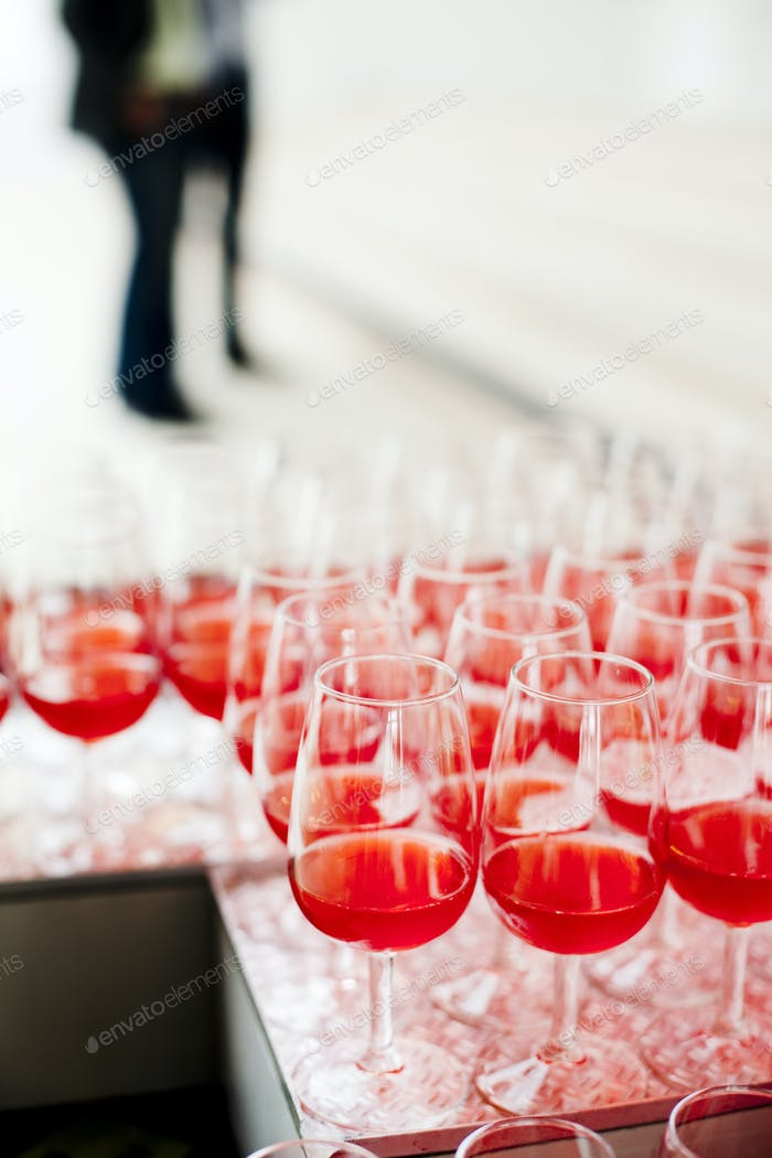 Rose wine in glasses on table
