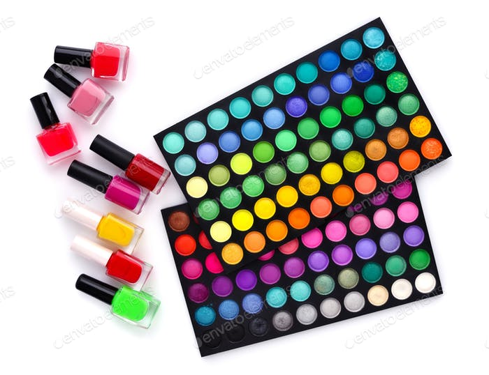 Set of decorative cosmetics and coloured nail polish bottles  on