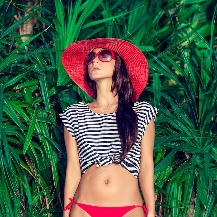 fashion portrait of a girl in the tropics