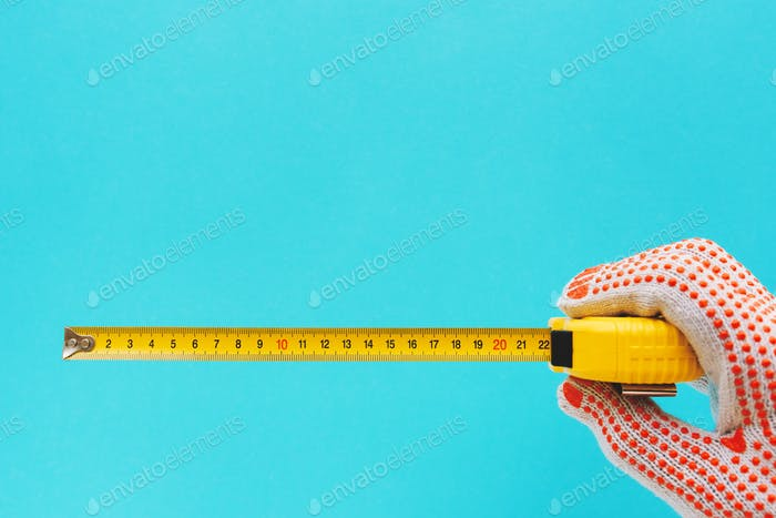 Handyman measuring size with tape meter
