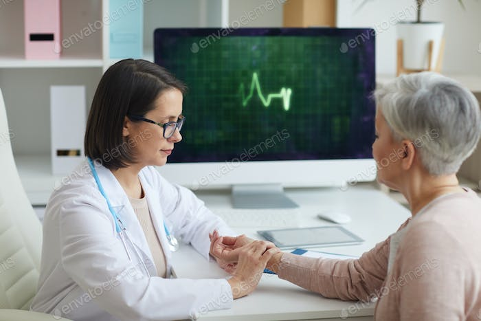 Doctor Checking Heart Rate of Senior Patient